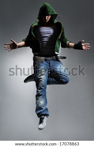 cool looking dancer makes a difficult jump - stock photo