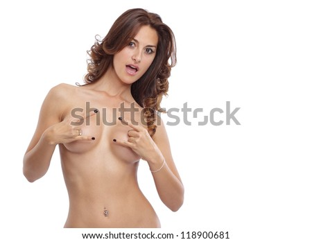 Cool looking topless woman in studio - stock photo