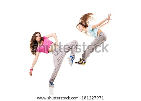 cool looking two dancing women isolated on white background - stock photo