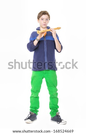 cool male teenager holding a flute, isolated on white. - stock photo
