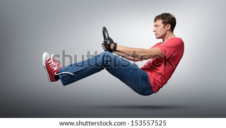 Cool man car driver in gloved with a wheel, auto concept  - stock photo