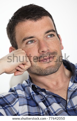 cool man on sofa at home - stock photo