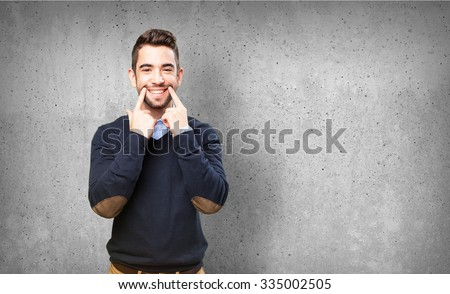 cool man pointing his smile - stock photo