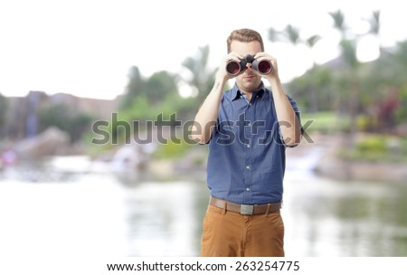 cool man with a binoculars in a safary - stock photo