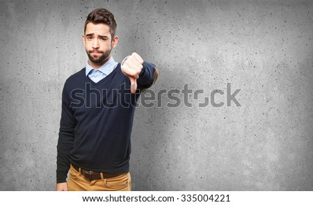 cool man with thumb down - stock photo