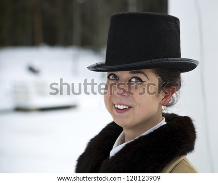 Cool portrait of smiling young woman with hat