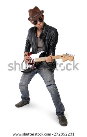 Cool pose of a young man playing electric guitar, isolated on white background