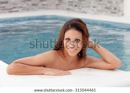 Cool pretty girl taking a dip in the pool - stock photo