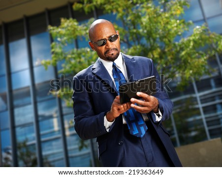 cool professional business executive with tablet - stock photo