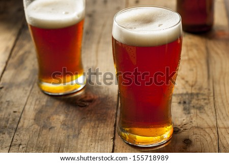 Cool Refreshing Dark Amber Beer against a Background - stock photo