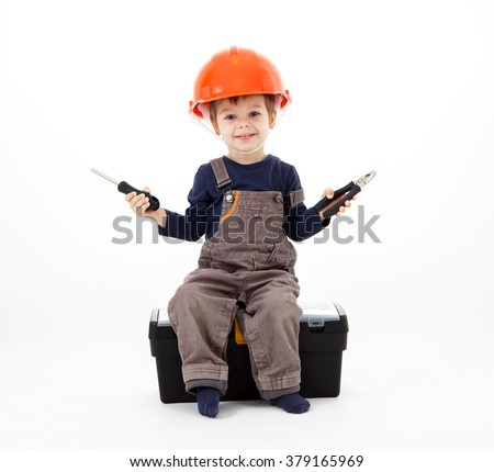Cool repairman in hardhat with pliers and screwdriver on white - stock photo