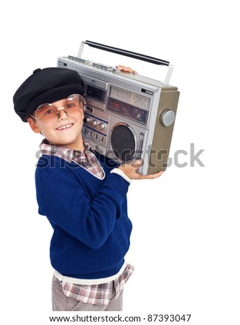Cool retro kid with cassette player and sunglasses - isolated - stock photo