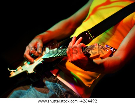 Cool rock guitar player  in a rock concert - stock photo