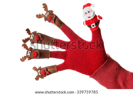 Cool Santa claus deer toy christmas decoration on the hand. Humorous concept festive fun - stock photo