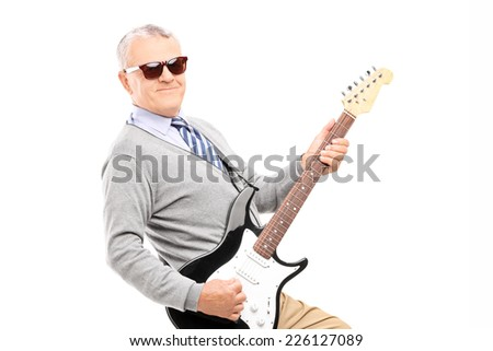Cool senior playing a guitar isolated on white background - stock photo