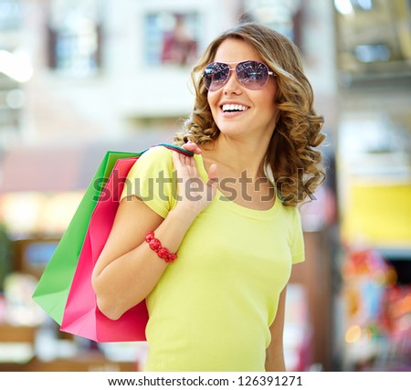 Cool shopping girl enjoying a carefree weekend at mall - stock photo
