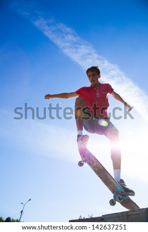 cool skateboard is jumping high in air - stock photo