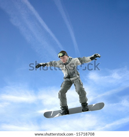Cool snowboarder jumping for the skies - stock photo