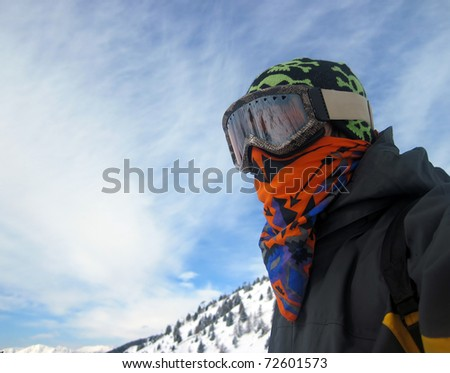 Cool Snowboarder Looking at the Slopes - stock photo