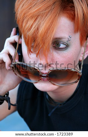 Cool teen at cell - stock photo