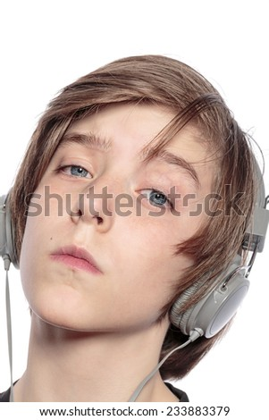 cool teenage boy with headphones, isolated on white - stock photo