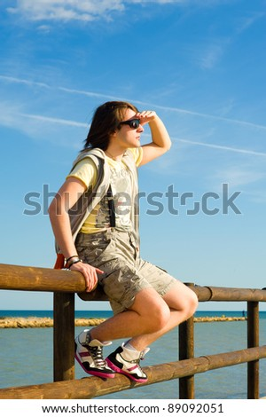 Cool  teenager in a very dynamic attitude - stock photo