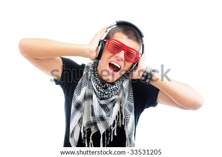 Cool teenager listening to music - stock photo
