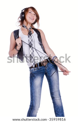 cool teenager listening to music and dancing - stock photo