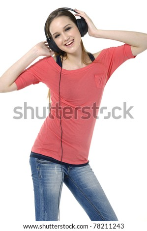 Cool teenager listening to music isolated on white - stock photo