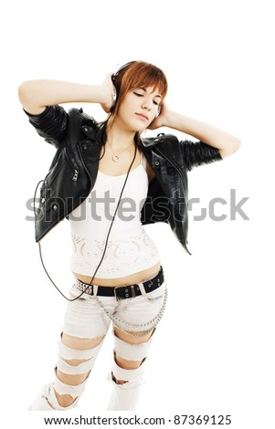 Cool teenager listening to music isolated on white background - stock photo