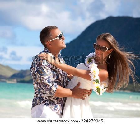 Cool trendy modern couple on summer holidays vacation on tropical Hawaiian beach, Waimanalo park - stock photo
