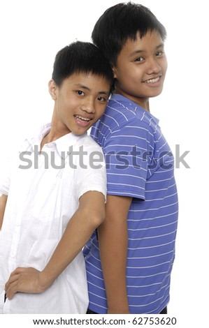 Cool two boys friends guys standing back to back looking at you - stock photo