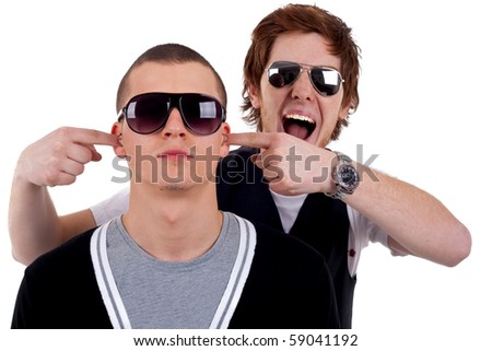Cool two friends guys fooling around with eachother - stock photo