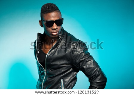 Cool urban stylish black american man. Fashion studio shot. - stock photo