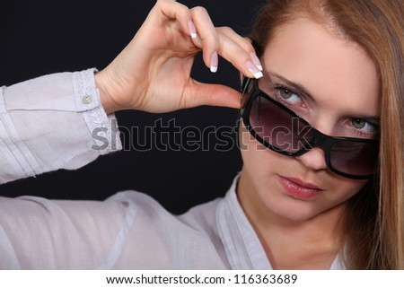 Cool woman in sunglasses - stock photo