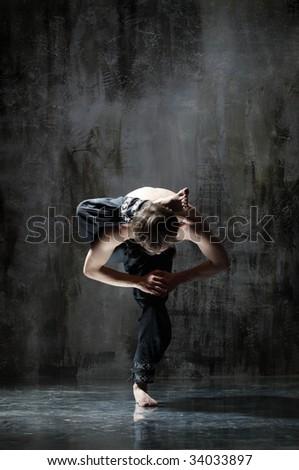 cool yoga man posing on dirty grunge background - stock photo