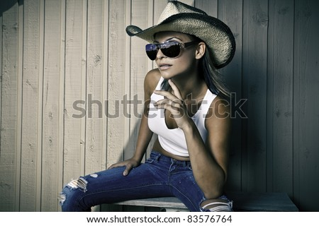 Cool young cowgirl - stock photo