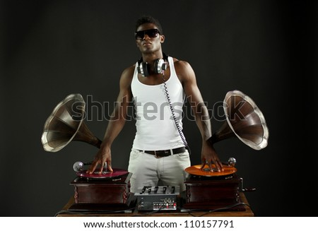 cool young man djs using two retro antique gramophones. cool and quirky concept clip - stock photo
