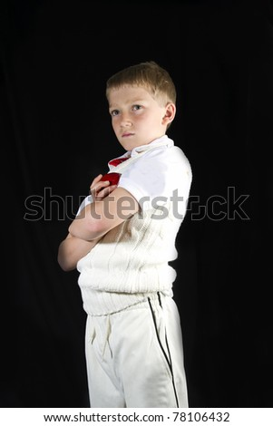 cool young man in cricket whites and a cricket ball