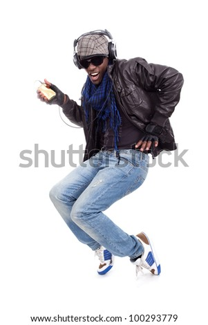 Cool young men dancing listening to music - stock photo