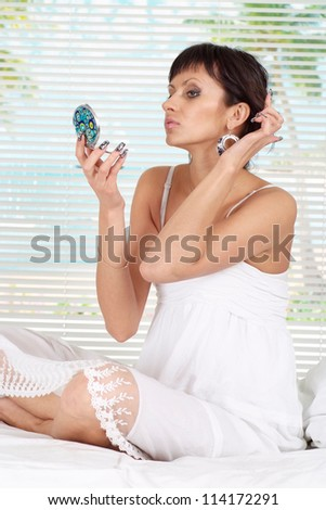 Cool young woman relaxing at the resort alone