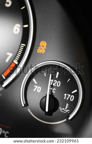 Coolant temperature gauge on a car's dashboard.