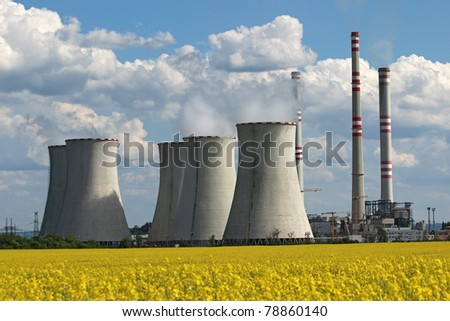 coolin tower and chimney of coal power plant over yellow field - stock photo