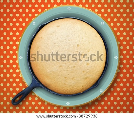 Cooling Cornbread baked in a skillet - stock photo