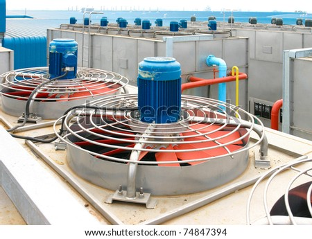 Cooling fans system on the roof of the frozen food factory - stock photo