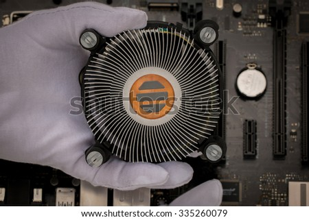 Cooling,New CPU heat sink with handle and background motherboard background. - stock photo