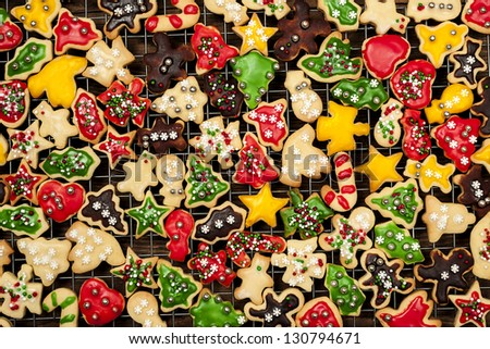 Cooling rack with freshly baked homemade shortbread Christmas cookies over wooden background from above - stock photo