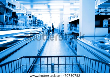 cooling shelves in a supermarket  blue light - stock photo