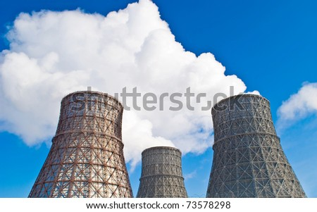 cooling tower against the blue sky - stock photo