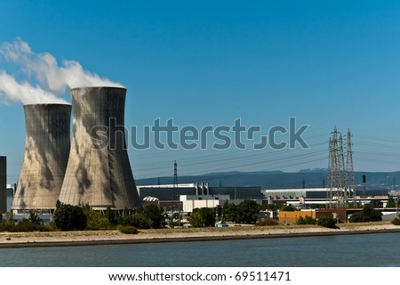 Cooling towers are heat removal devices used to transfer process waste heat to the atmosphere. - stock photo